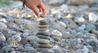 Immagine di A person stacking pebbles