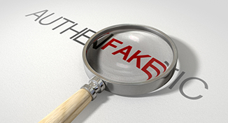 Immagine di A magnifier on the word fake